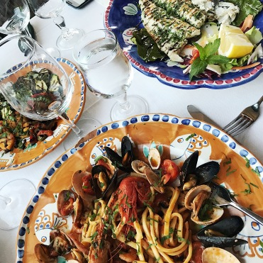 Seafood pasta, roasted veggies, and grilled fish. We ate it all.
